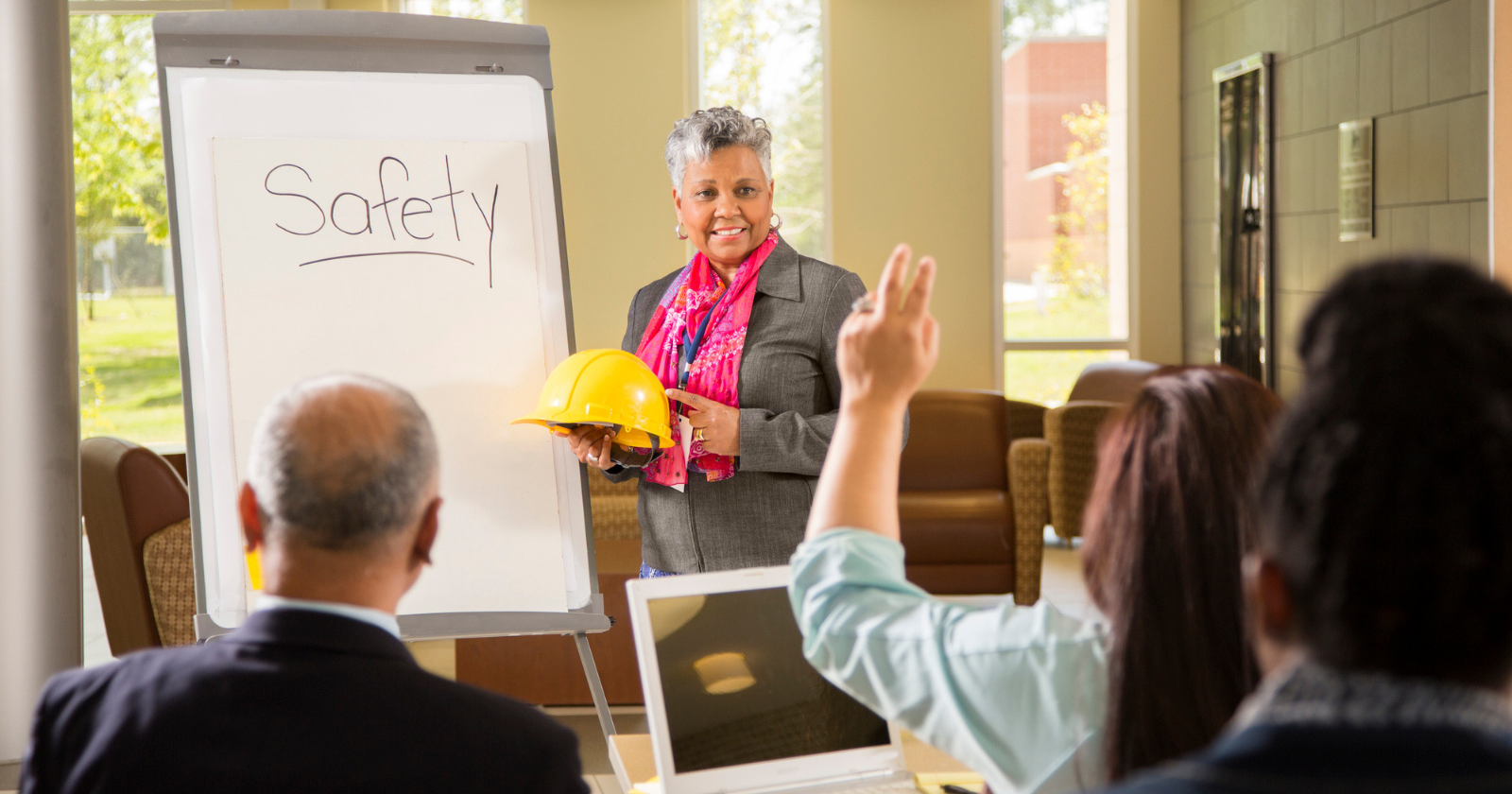 Woman teaching safety lesson in a workplace